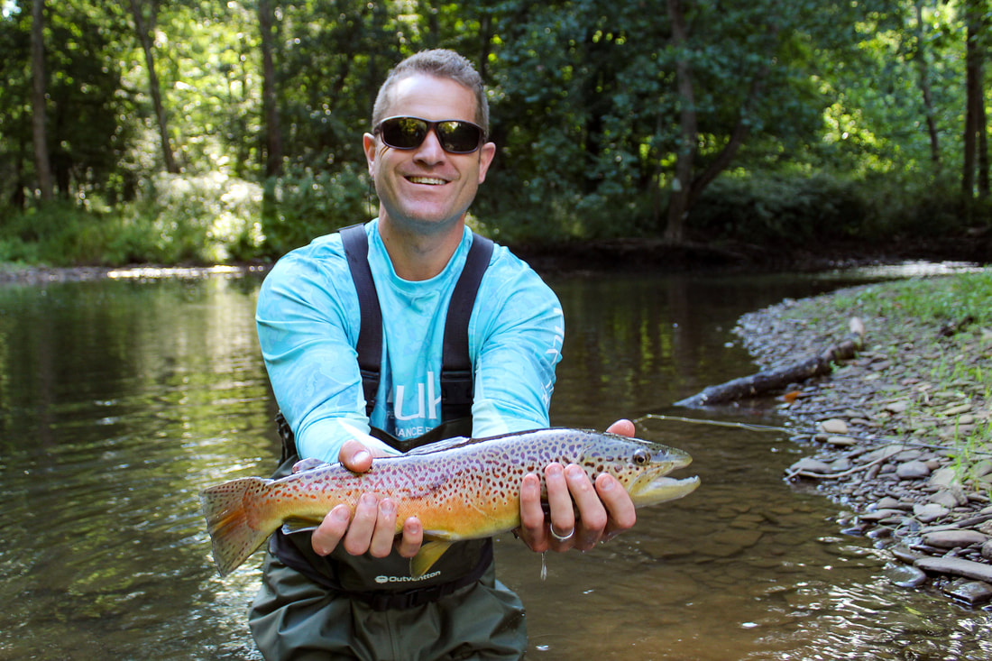 Trophy brown trout fly fishing guide trips.